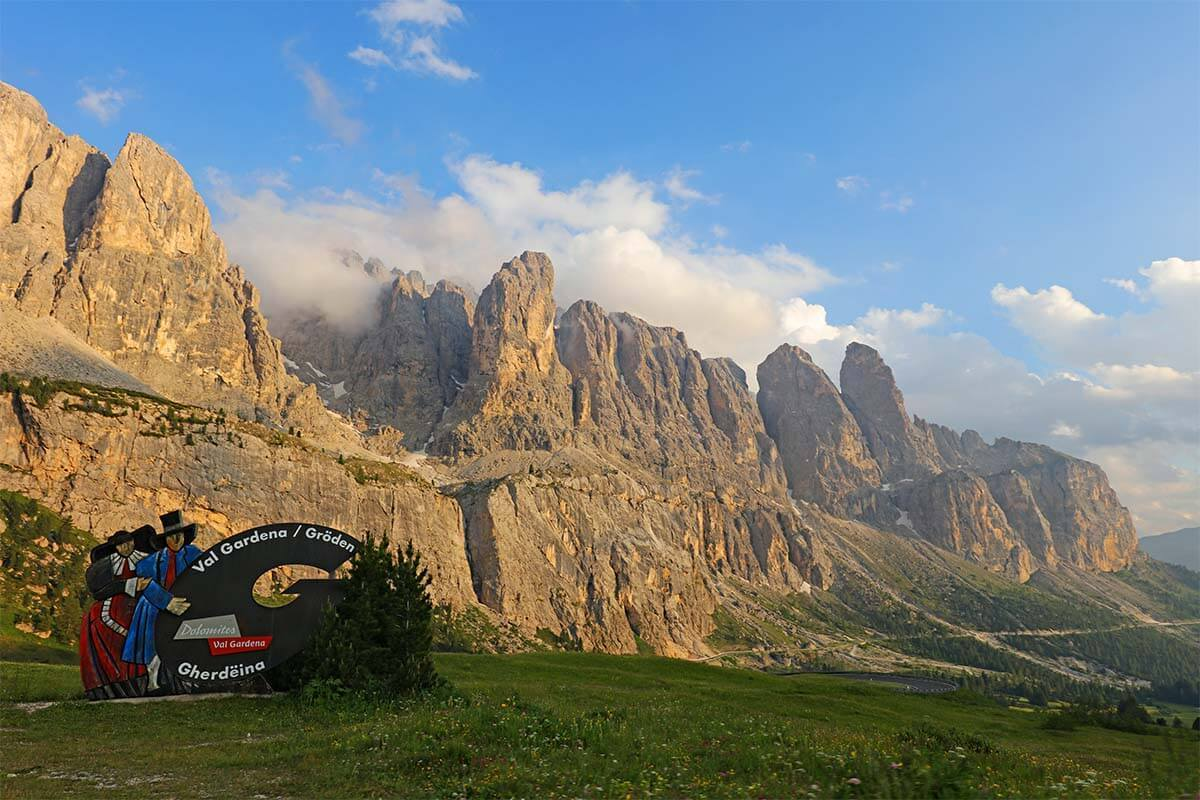 Val Gardena sign and mountain scenery at Gardena Pass in the Dolomites Italy