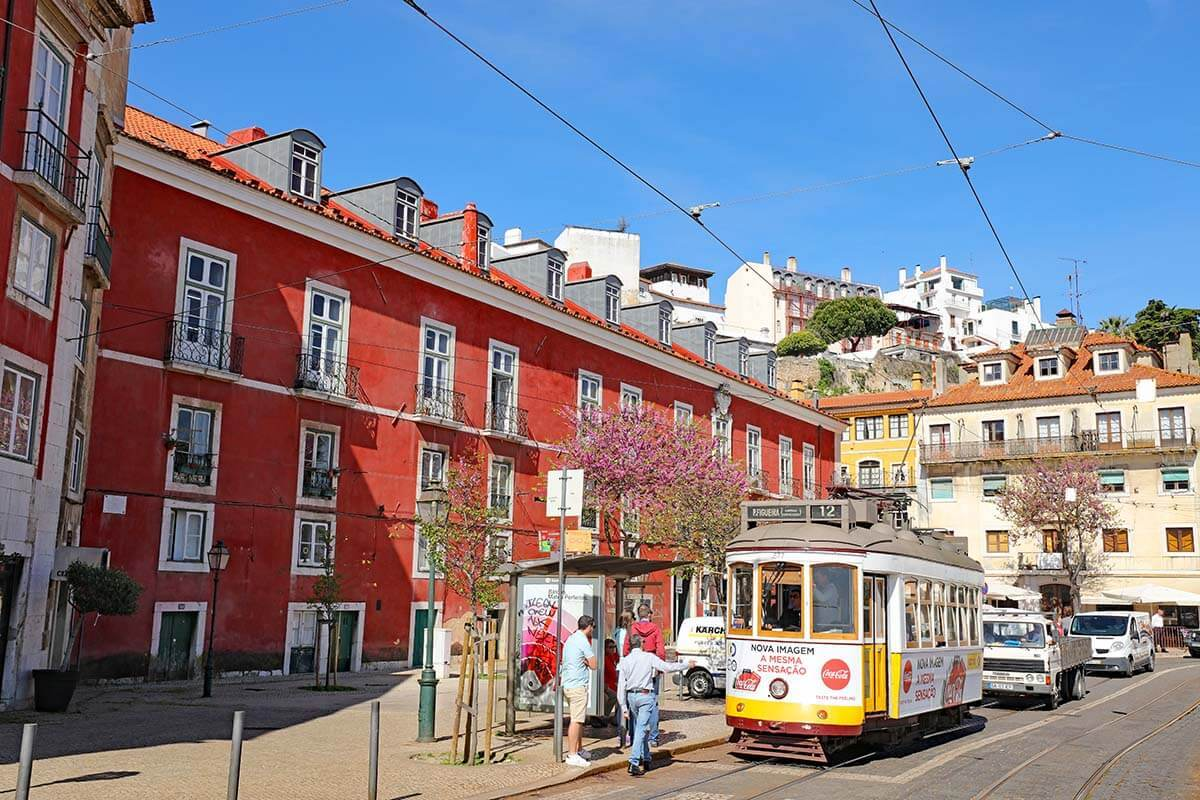 Colorful buildings and traditional tram in Alfama Lisbon