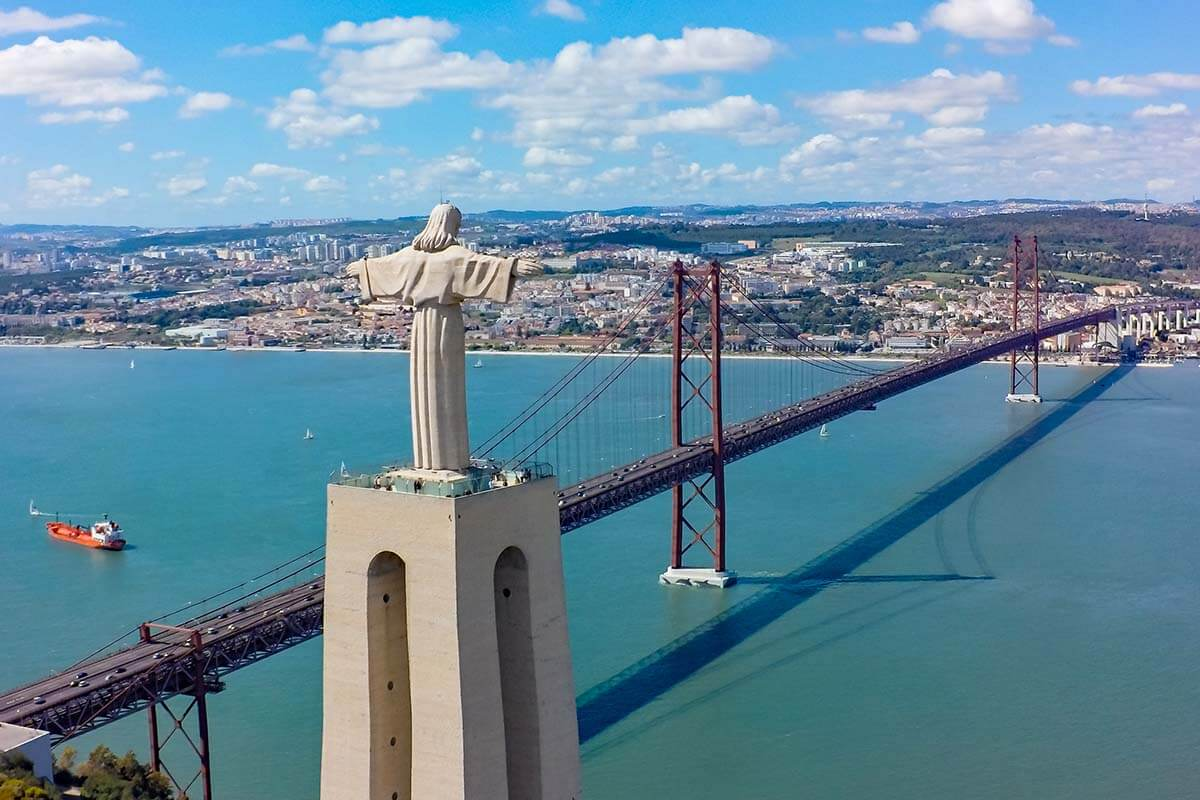 Cristo Rei statue and April 25 Bridge in Lisbon