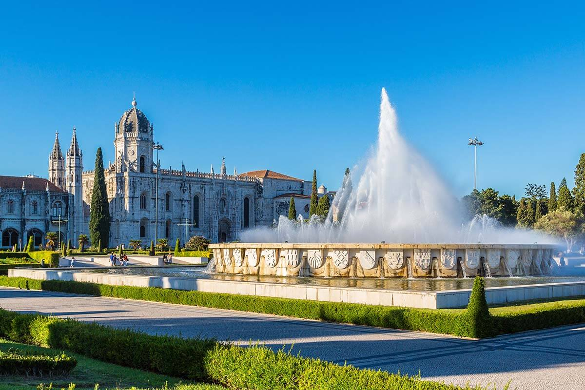 Jeronimos Monastery as seen from Praca do Imperio Gardens with a fountain