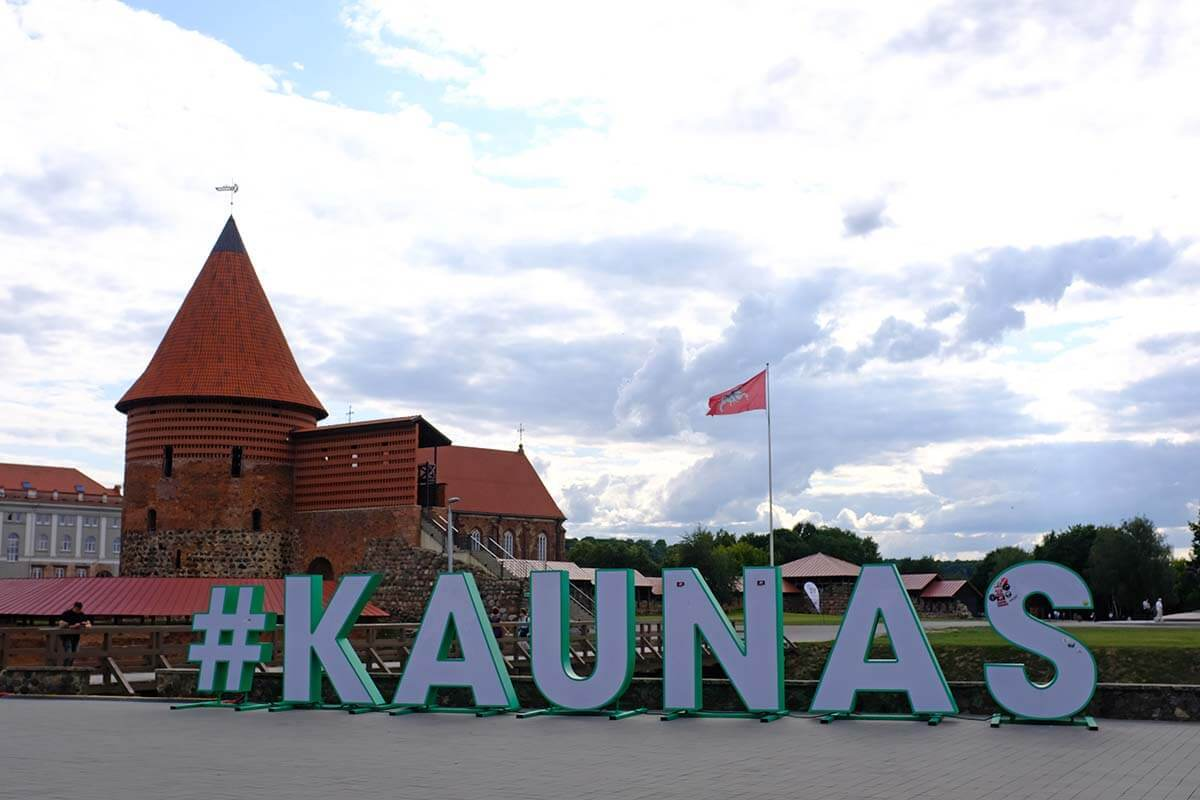 Kaunas sign and castle in Lithuania