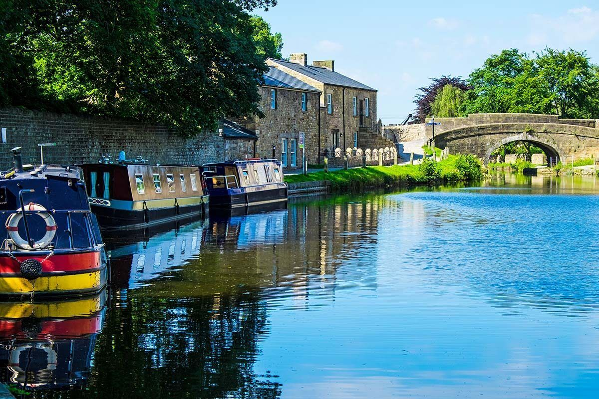 Lancaster Canal, boats, and a stone bridge
