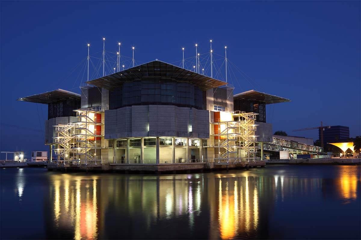Lisbon Oceanarium building lit at night