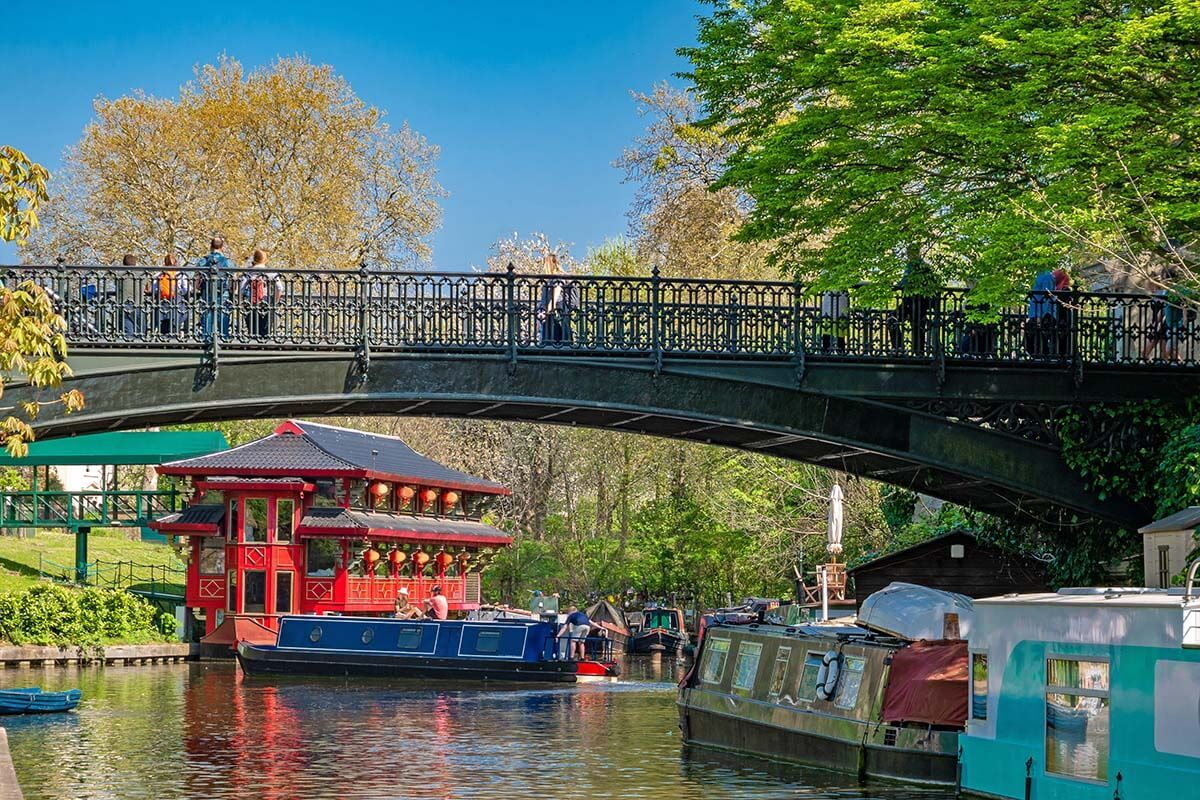 Regent's Canal with colorful boats and floating Chinese pagoda restaurant