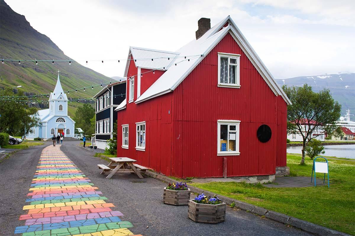 Seydisfjordur rainbow path and church in eastern Iceland