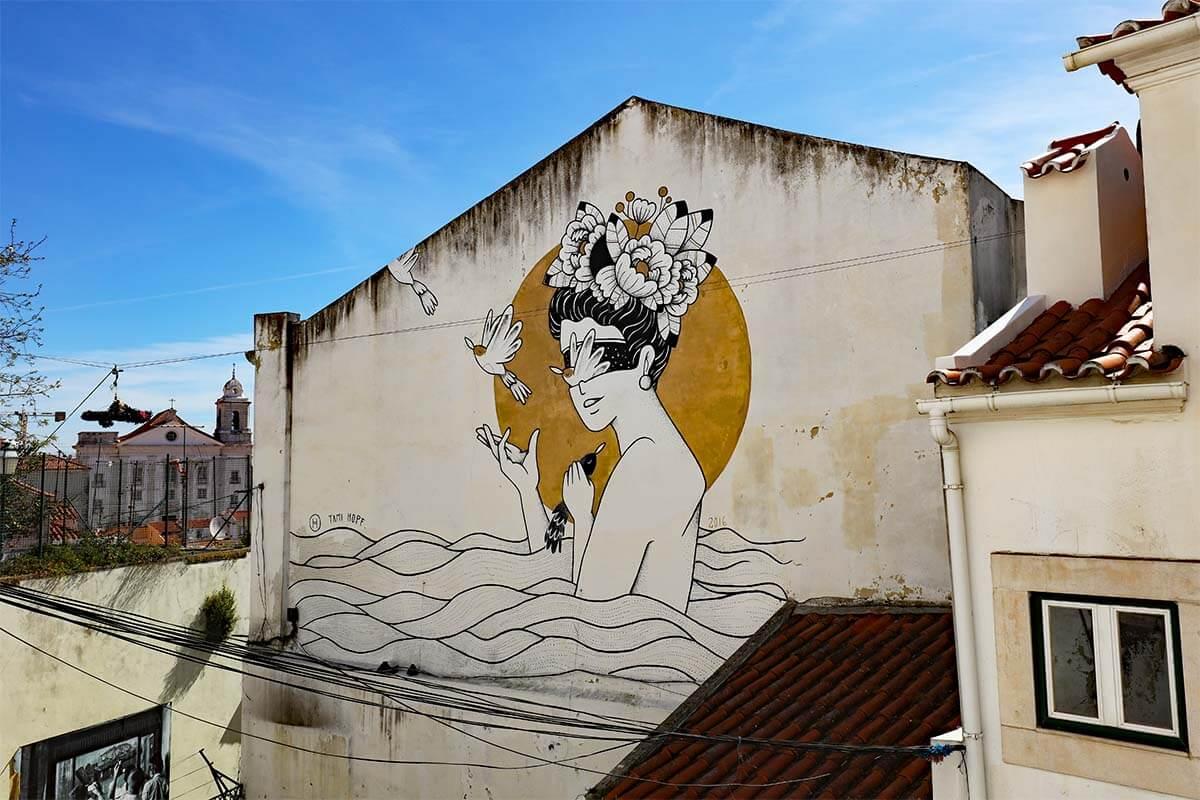Street art in Alfama neighborhood in Lisbon