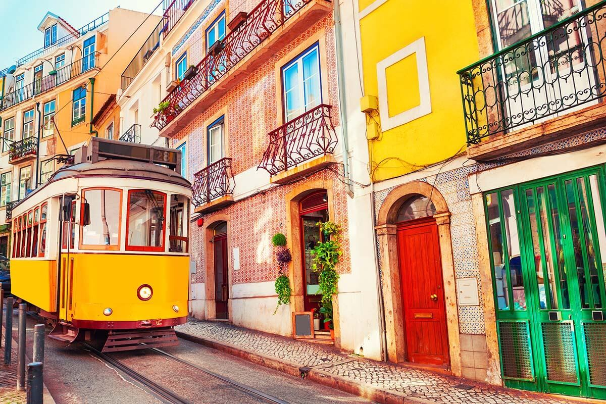 Yellow tram and colorful buildings in Lisbon Portugal