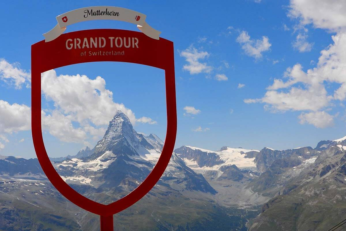 Grand Tour of Switzerland sign with Matterhorn view from Rothorn in Zermatt