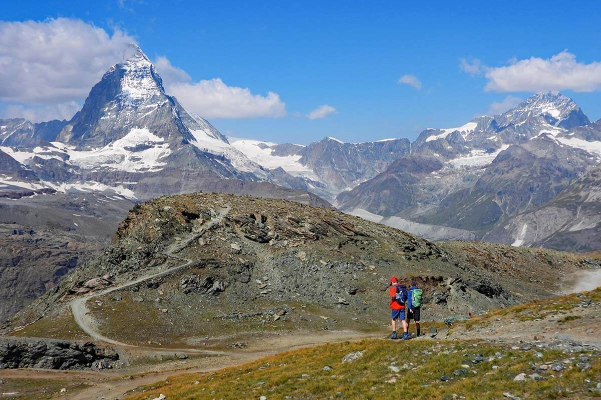 Kids hiking from Gornergrat to Riffelsee with view of the Matterhorn in Zermatt