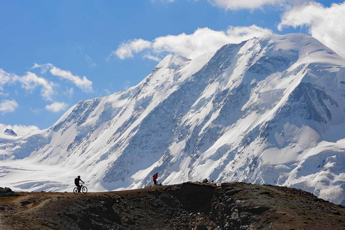 Mountain bikers and majestic scenery near Gornergrat in Switzerland