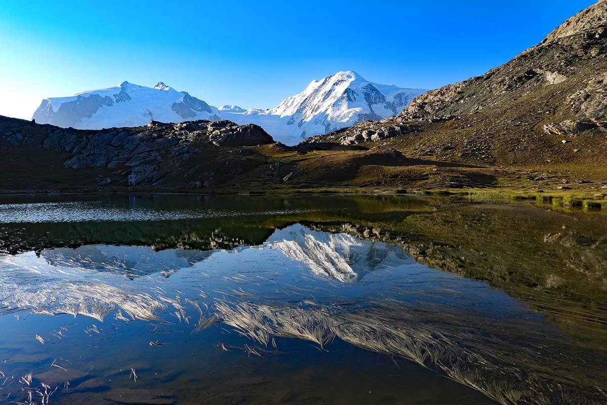 Mountain reflections on Riffelsee lake in Zermatt
