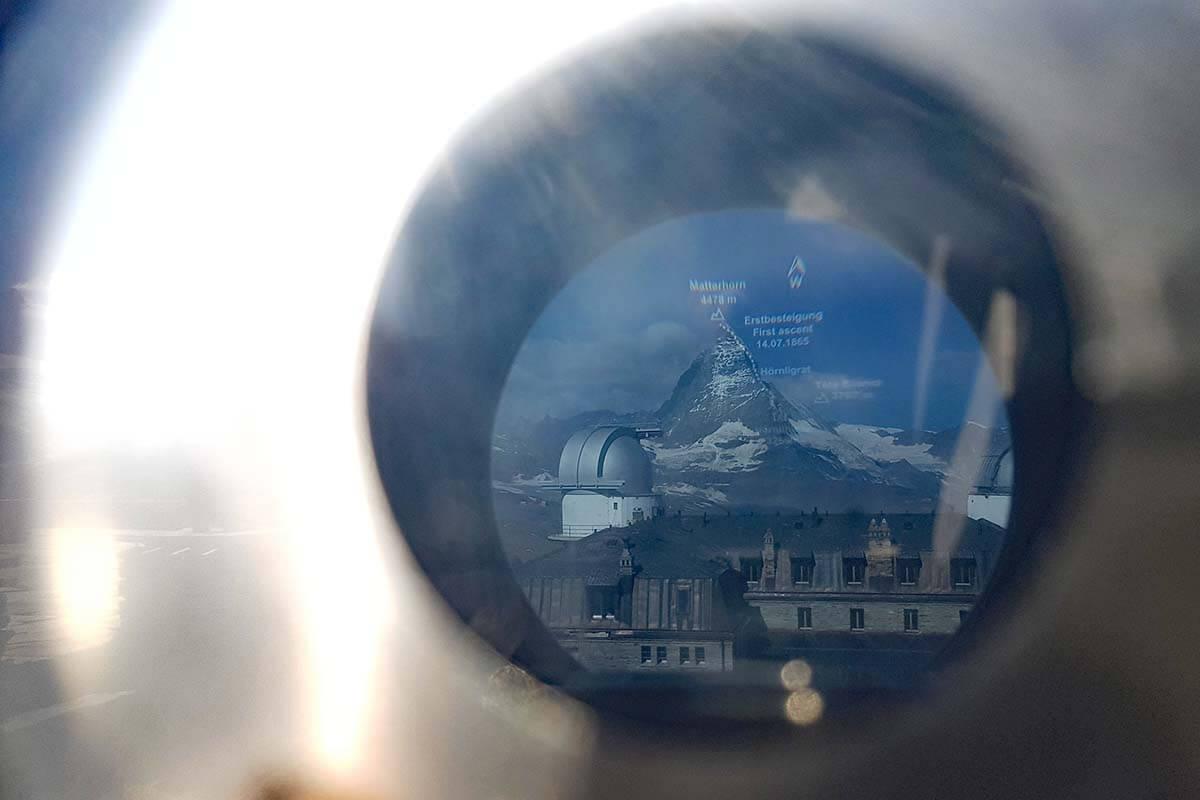View of the Matterhorn and Gornergrat hotel via binoculars at the viewing platform in Gornergrat